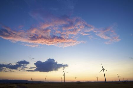 windmills group with colorful sky photo
