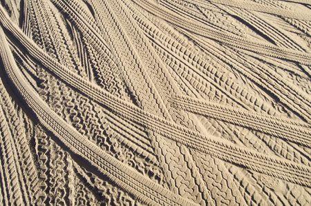 Car tire tracks in the sand; Utah desert, Usa