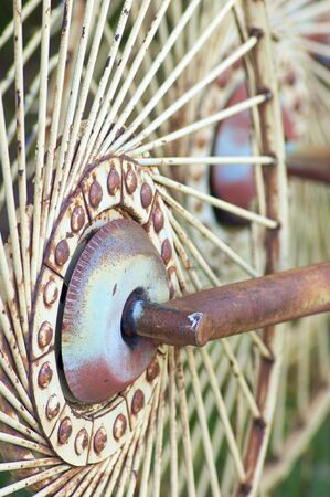agricultural implements: Detail of a rusty wheel of an agricultural implements