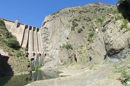 Hydroelectric dam with blue sky in Spain photo