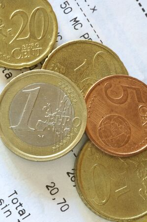 five cents: detail of euro coins and ticket