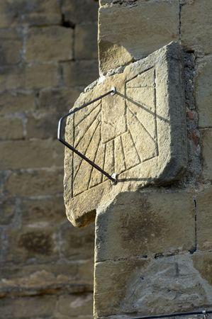 Old sundial in a stone facade photo