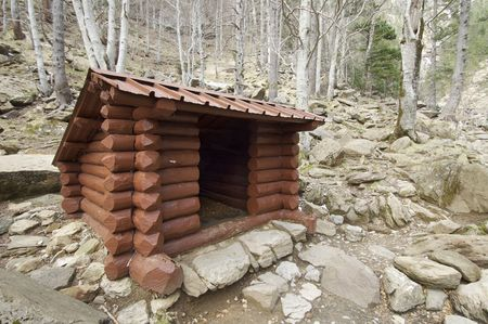 ordesa: wooden shelter in a beech forest in the national park of Ordesa