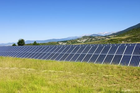 photovoltaic panel: Solar field with blue sky Stock Photo