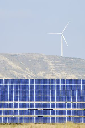 photovoltaic panels and windmill in the hill photo