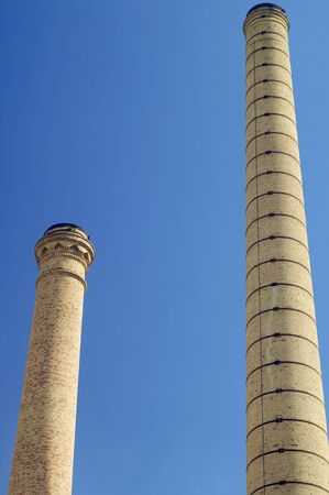 Two old brick chimneys from below Stock Photo - 6147859