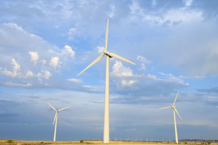 windmills group with cloudy sky Stock Photo - 6147853