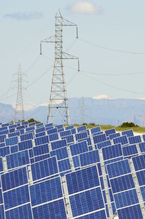 Huge solar field and high tension poles Stock Photo - 6148107