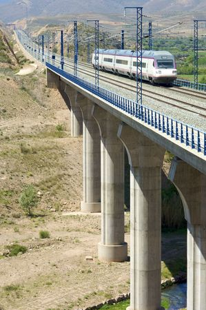 train running on a viaduct Stock Photo - 6159940
