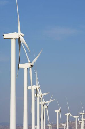 windmills group with blue sky photo