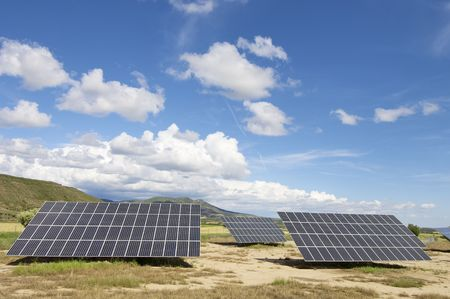Solar field with blue sky with clouds photo