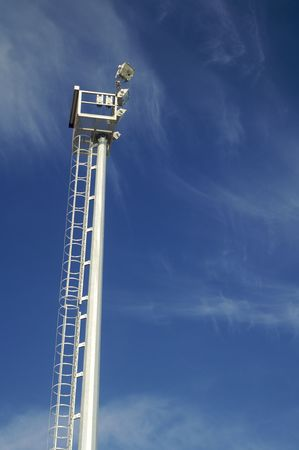 Floodlight with blue sky and clouds photo