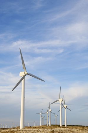 windmills group with cloudy sky photo