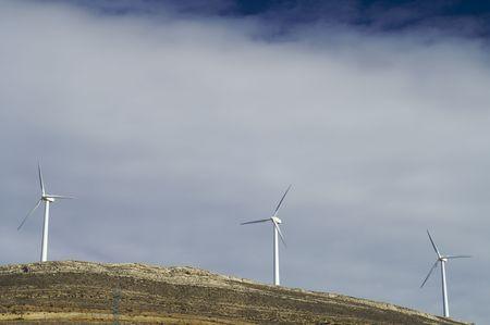 Tree winmills in a hill photo