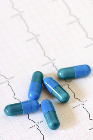 fall arrest: Detail of an electrocardiogram in paper and capsules
