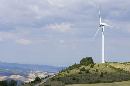 lone windmill on a hill photo