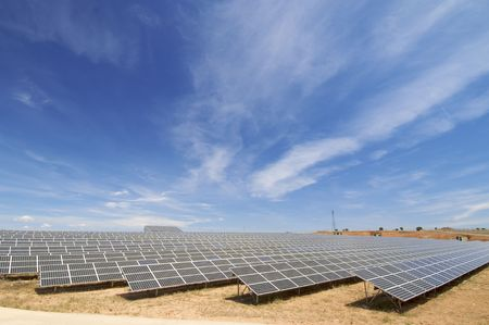 huge solar field with cloudy sky photo