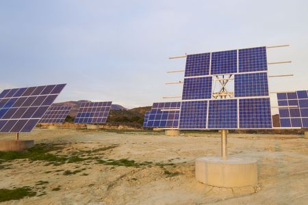 Solar field with blue sky in the sunset photo