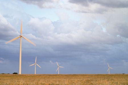 Wind power aerogenerator skyline at sunsite photo