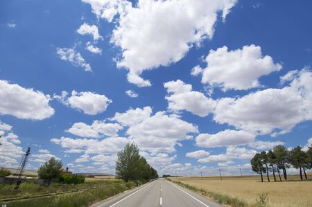 asphalt road and clouds photo