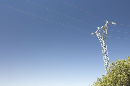 High tension electrical tower with blue sky Stock Photo - 6242108