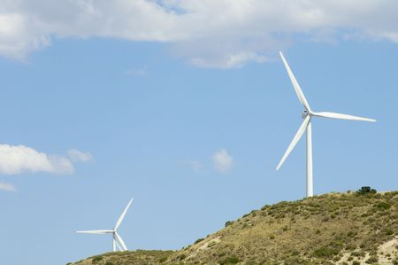 two windmills in a hill photo