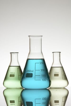 three beakers with color liquid photo