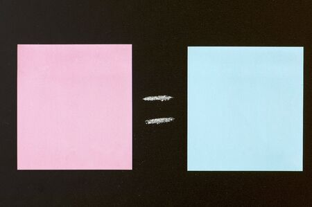 impartiality: blue and pink paper in a blackboard