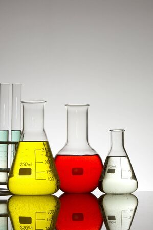 matrass: bottles of transparent glass laboratory Stock Photo