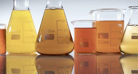matrass: group of flasks and beakers with liquid orange Stock Photo