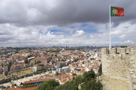 Portuguese flag waving in castle of St. George, Lisbon, Portugal photo