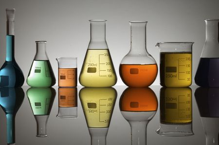 laboratory containers with multicolored liquids