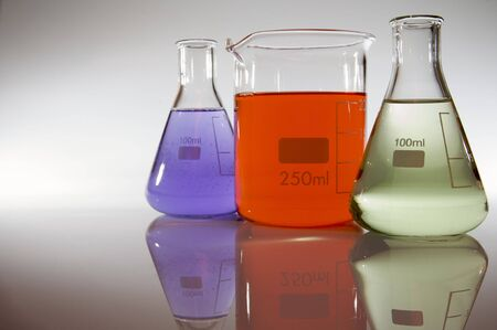 two flasks and a beaker with colored liquid photo