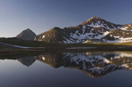 Mountains and lake in Pyrenees, Spain photo