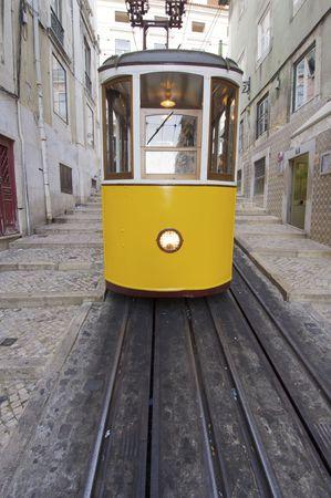 yellow tram on a street in Lisbon, Portugal