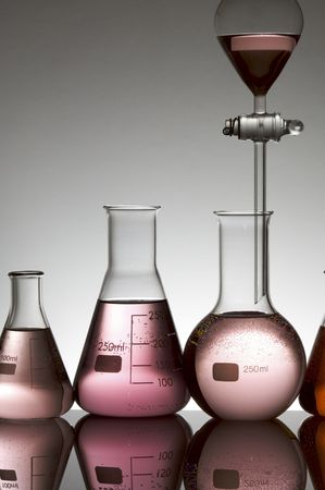 laboratory equipment with pink fluid Stock Photo