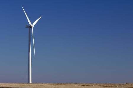 lone windmill with a clear blue sky photo