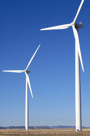 two windmills with a clear blue sky photo