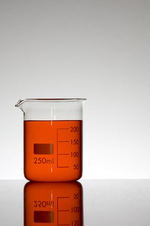 milliliters: capacity beaker with two hundred and fifty milliliters of red liquid