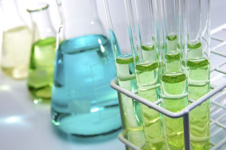 test tubes and flasks with green and blue liquid in a laboratory Stock Photo - 6588861