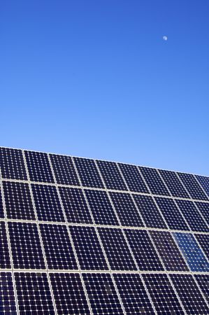 photovoltaic panel and blue sky with little moon Stock Photo - 6588863