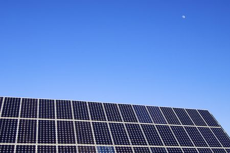 photovoltaic panel and blue sky with little moon photo