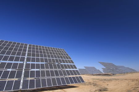huge solar panels and clear sky photo
