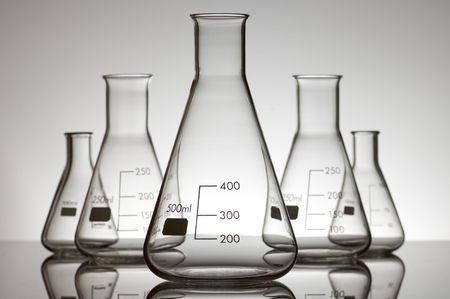 milliliters: five empty flasks on a white backlight