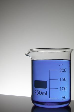 beaker with purple liquid at backlit photo