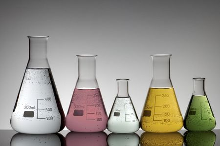 milliliters: group of laboratory flasks with colored liquid Stock Photo