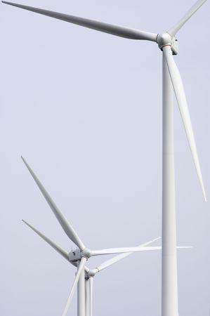 three windmills white and cloudy sky photo