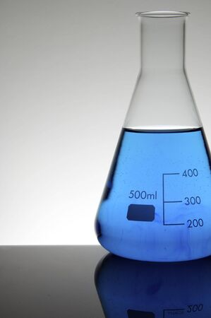 scientifical: laboratory flask with liquid blue and white background Stock Photo