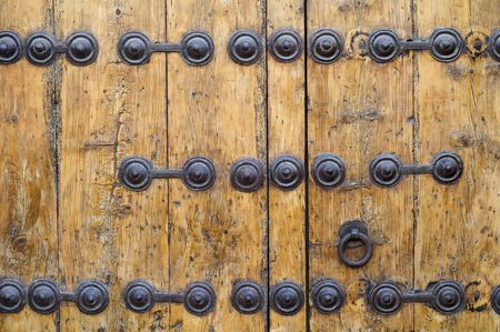 detail of an old wooden door metal parts in Siguenza, Spain photo