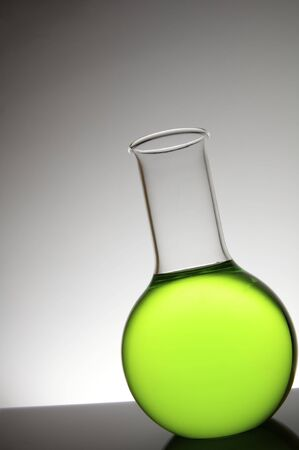 angled view: Angled view of a flask with green liquid